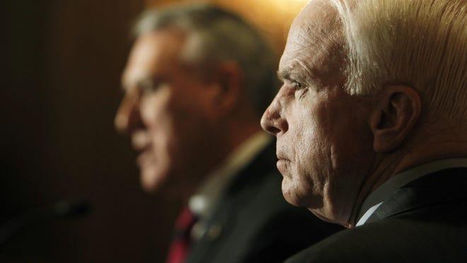 Then-Sen. Jon Kyl and Sen. John McCain in 2010