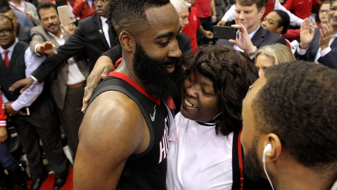 Houston Rockets guard James Harden (13) is greeted by his mother, Monja Wills, following Houston's 114-107 victory over the Orlando Magic at Toyota Center. Harden finished the game with a career and franchise high 60 points.
