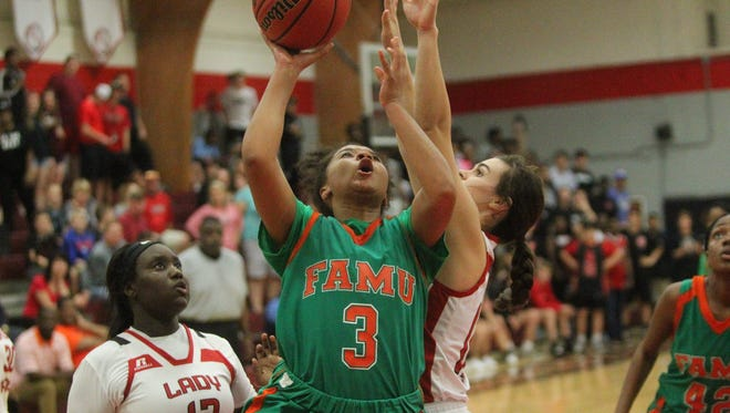 LaKrista Walker and FAMU DRS beat NFC 50-49 in a Region 1-3A final.