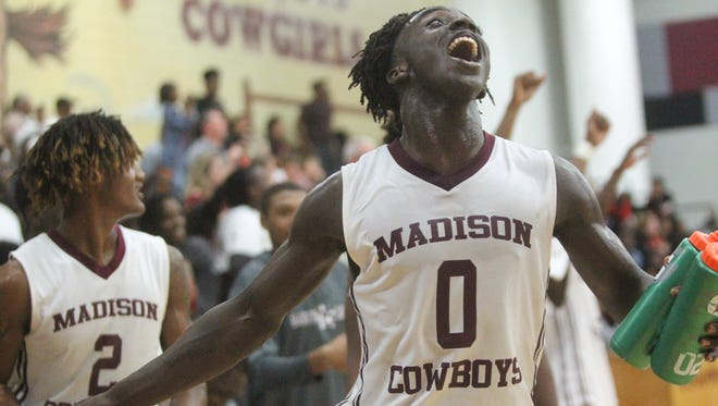 Madison County point guard Travis Jay celebrates a 70-40 win over Hawthorne in a Region 3-1A final that put the Cowboys in the state tournament for the first time.