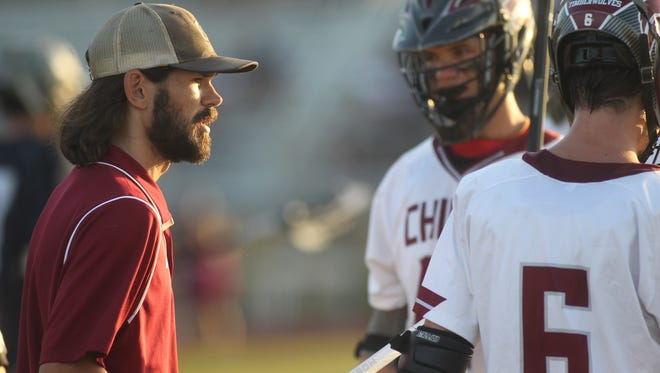 Chiles lacrosse coach Chris Anders talks with his team during a break in action.