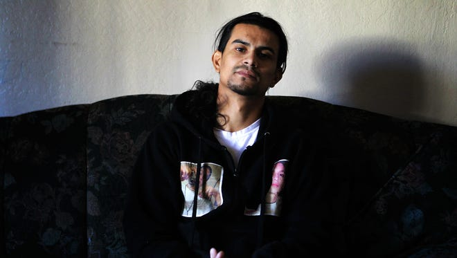 Javier Arango, 29, sits in his Oakland apartment on March 5, 2018. Arango was paralyzed from a bullet to his spine in 2006, after which he joined a gang for protection. He's one of the gunshot survivors featured in the podcast Aftermath.
