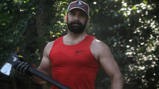 Tallahassee resident Patrick Slevin, 49, prepares for his upcoming Peak Death Race through unconventional workouts in his backyard.