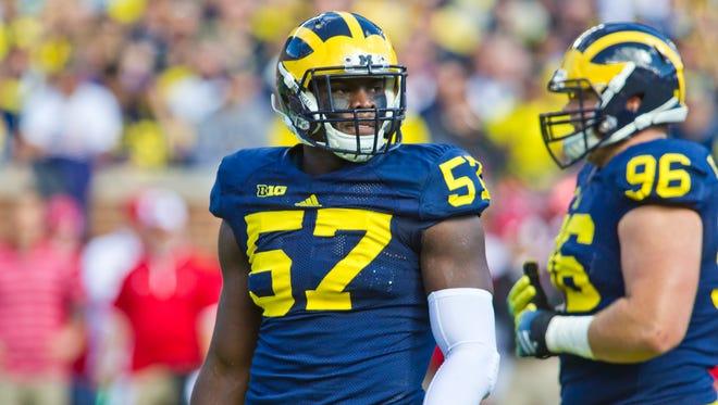 Michigan defensive end Frank Clark (57) plays against Miami (Ohio) in Ann Arbor on Sept. 13, 2014.