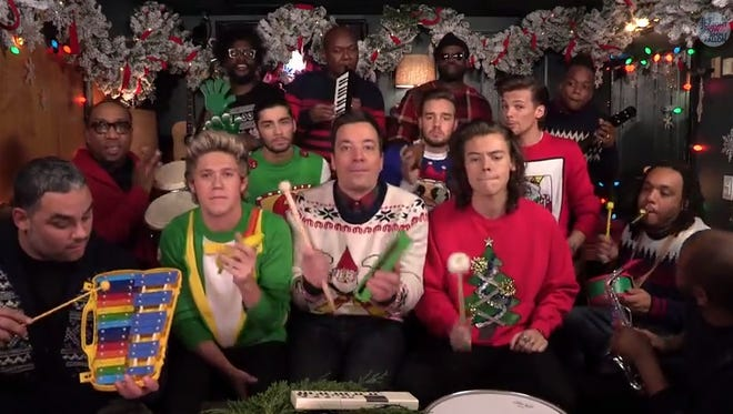 One Direction, Jimmy Fallon and his Tonight Show house band The Roots sing Christmas music in this video.