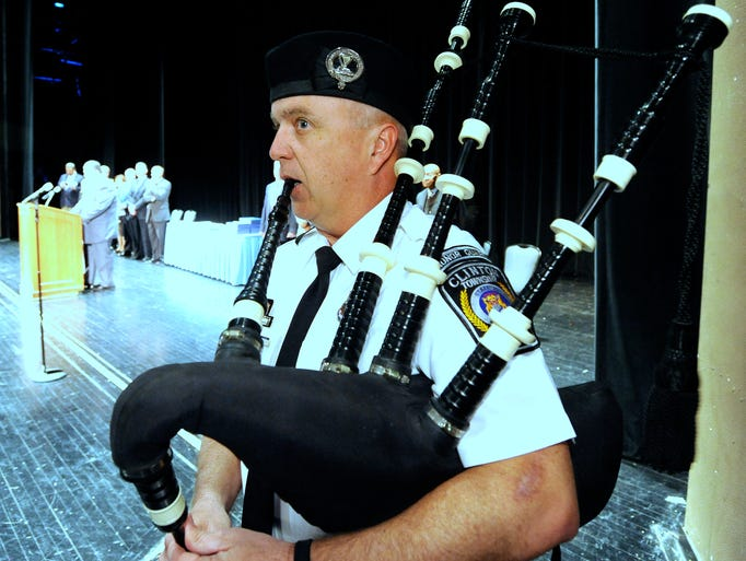 Marysville Police Officer James Disser plays the bagpipes