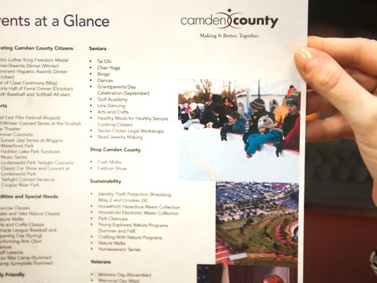 Sandi Kelly, Camden County's director of events and community outreach. holds a Camden County event list. 02.09.15