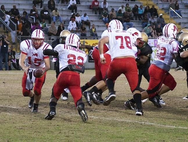Leon alum Trey Braun (78) pulls on a run during a 2010 game against Lincoln. Braun is a starting offensive lineman for Georgia Tech.
