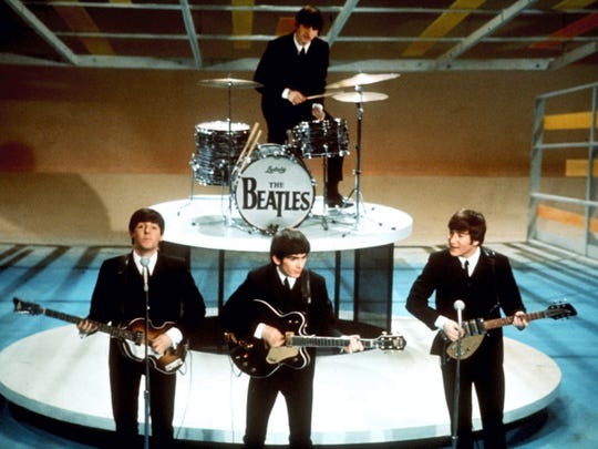 "The Beatles perform on  CBS's ""Ed Sullivan Show"" in New York on Feb. 9, 1964."