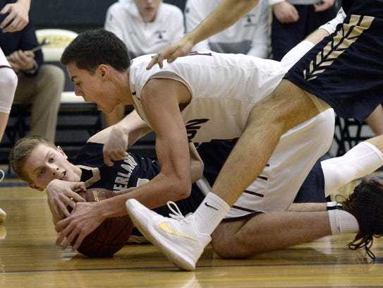 Pittsford Sutherland's Matt Panara, left, and Pittsford Mendon's Daniel Cook fight for a loose ball during the Rainbow Classic at the University of Rochester on January 19.