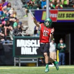 Oregon Ducks quarterback Morgan Mahalak (16) throws the ball down the field at Autzen Stadium.