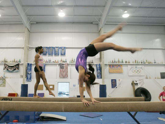 Gymnasts practice at Geist Sports Academy in 2009.