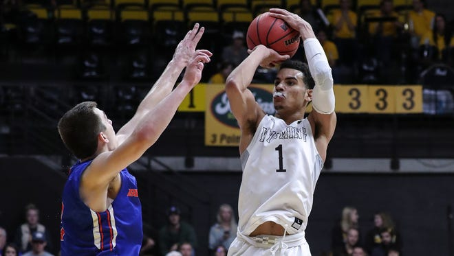 Wyoming's Justin James puts up a shot Saturday during the Cowboys' win over Boise State in Laramie, Wyo. It was the second home win for Wyoming over one of the Mountain West's top teams  in the first two weeks of league play.