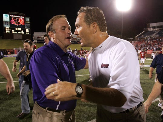 FILE - In this Sept. 10, 2005, file photo,  TCU head coach Gary Patterson, left, congratulates SMU head coach Phil Bennett, right, after SMU upset TCU 21-10 in an NCAA college football game in Dallas. Patterson has again told his team about 2005, when the Horned Frogs' only loss was to SMU. That is the coach's annual reminder about that loss to the Mustangs right after a season-opening win at seventh-ranked Oklahoma. The two schools meet on Saturday. (AP Photo/LM Otero, File)