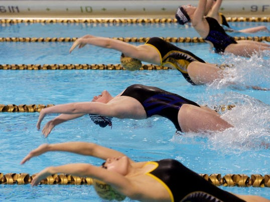 New Oxford and Red Lion girls swim the 100-yard backstroke.