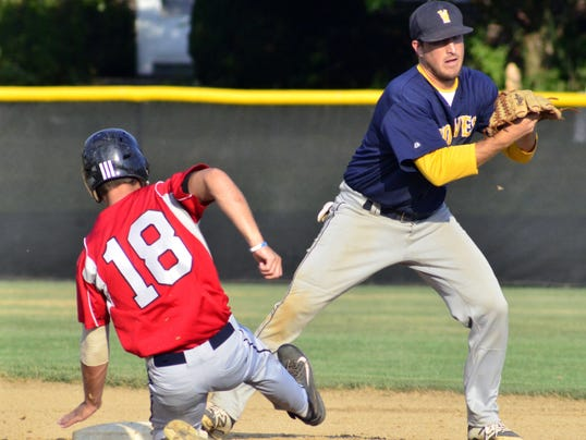 Dover's Ross Drawbaugh slides into second base hard to stop Mount Wolf shortstop Dustin Kuhn from completing a double play in the Wolves' 8-1 Central League victory on Monday.