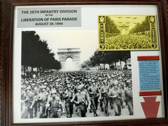 From the classic photo of the 28th Infantry Division marching through Paris to celebrate the city's liberation came the only U.S. postage stamp that featured an Army division.