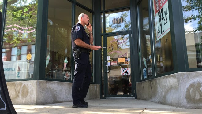 Police secure the entrance to Kathy's Kandies in Lafayette after a reported armed robbery at about 9 a.m. Friday.