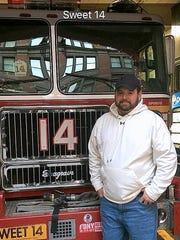 Southport volunteer firefighter Chris Baldwin stands