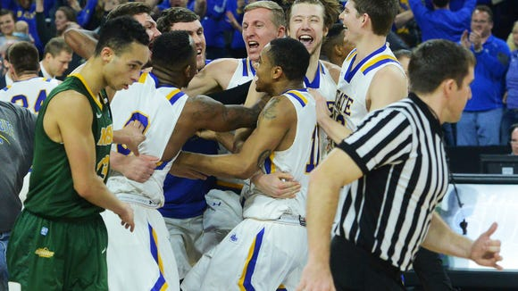 South Dakota State celebrates its 67-59 win over NDSU in the Summit League men's basketball championship Tuesday at the Denny Sanford Premier Center.