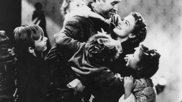 American actors James Stewart (1908 - 1997) and Donna Reed (1921 - 1986) star in the film 'It's a Wonderful Life', 1946. The children are Jimmy Hawkins (Tommy Bailey), Karolyn Grimes (Zuzu Bailey), Larry Simms (Peter Bailey) and Carol Coombs (Janie Bailey).
