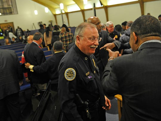 Nashville Police Chief Steve Anderson talks with clergy during a prayer vigil that was held at the Jefferson Street Missionary Baptist Church Wednesday evening to reflect and discuss the events that have occurred over the past few days in Ferguson and across the nation. Wednesday Nov. 26, 2014, in Nashville, TN.