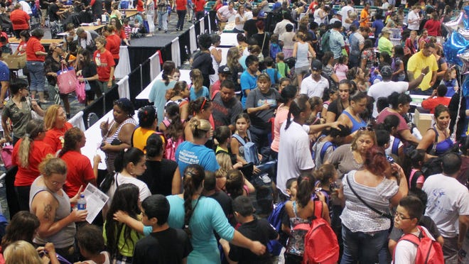 Thousands of youth and their parents crowd Harborside Event Center while receiving much needed school supplies during the Big Backpack Event at Harborside Event Center in Fort Myers.