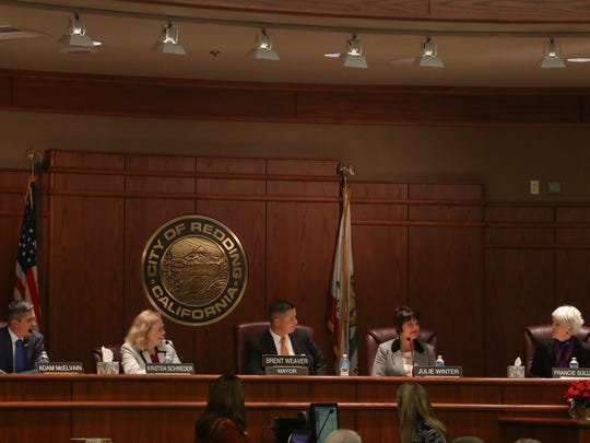 Adam McElvain (left) and Julie Winter (second from right) take their seats Tuesday on the Redding City Council.