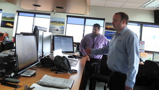 Staff members man the operations center at Morristown Municipal Airport.