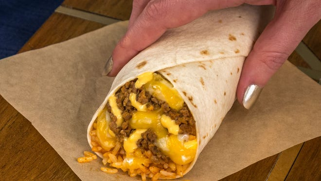 The Triple Melt Burrito is one of the new items debuting on its dollar menu on Thursday, April 5, 2018.