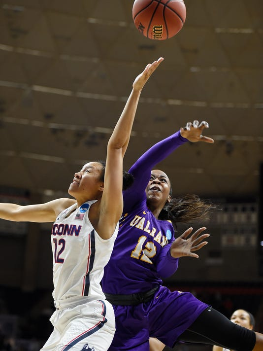 Albany's Imani Tate, right, blocks a shot attempt by Connecticut's Saniya Chong, left, during the second half of a first round round of a women's college basketball game in the NCAA Tournament, Saturday, March 18, 2017, in Storrs, Conn. (AP Photo/Jessica Hill)