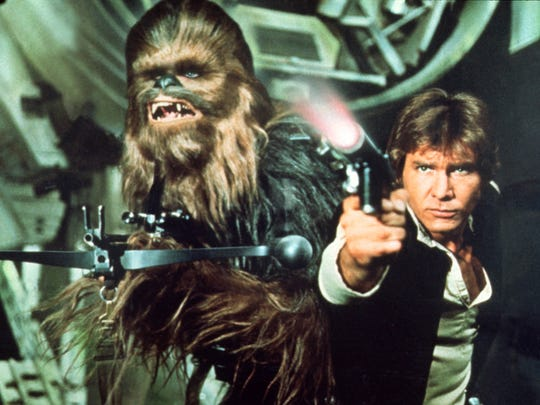 Peter Mayhew as Chewbacca and Harrison Ford as Han