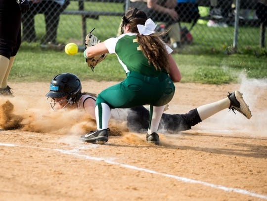 Delone Catholic's Sydney Keith slides safely into home,
