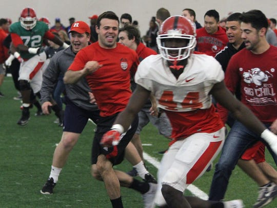 At Rutgers Student Appreciation Day earlier this month, students participated in warm-up exercises alongside the football team to start off a practice.