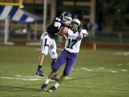 Mifflin County's Nathan Bargo tries to grab a pass