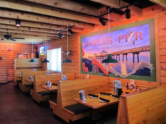 The Naples Pier is featured on one wall of a dining
