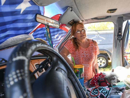 Betty Parker of Hollywood, Florida sits in her van
