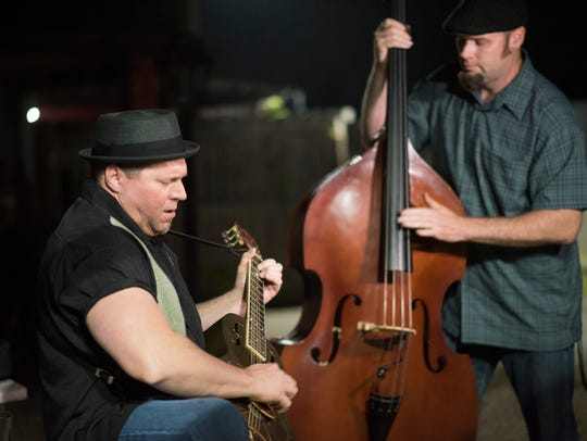 Guitarist Scott Riggs and bassist Jeremy Holcombe play