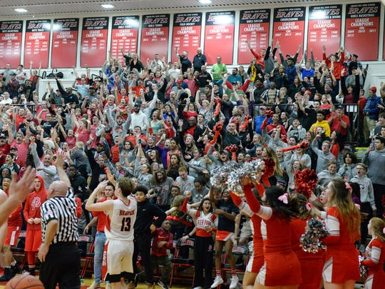 Deer Park students and fans erupt after Damani Mcentire hits the game winner against the Braves at Indian Hill High School, Friday Feb. 9, 2018