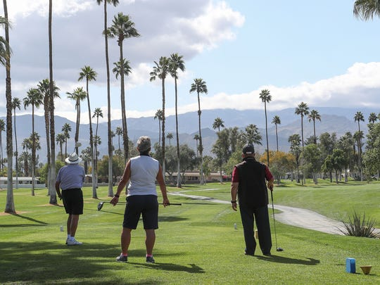 Golfers tee off on the first hole at Shadow Mountain Golf Club in Palm Desert, February 22, 2018.