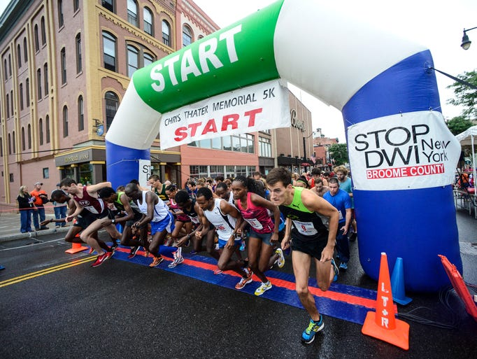 Runners take off down the Court Street Bridge during the start 20th annual Chris Thater Memorial 5K on Saturday.