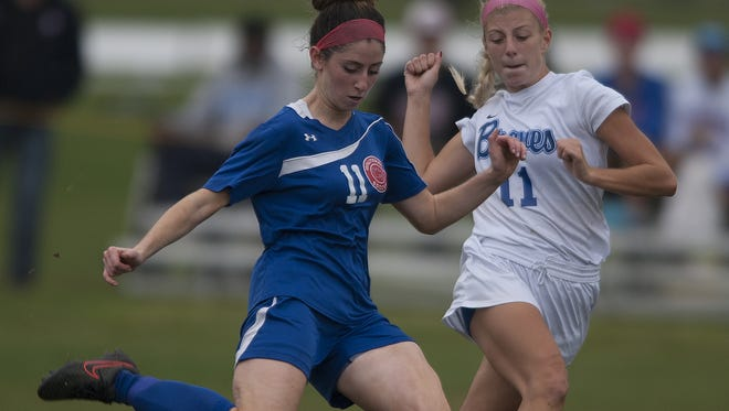 Washington Township's Kylie D'Ambra, takes a shot on goal as she battles with Williamstown's  Nicolette Gentile, 11, in the second half of the Minutemaids' 1-0 win in the Group 4 South quarterfinals. D'Ambra scored the game's only goal.