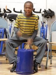 Caylone Francois, a fourth-grader at Franklin Elementary School,  drums on a five-gallon bucket Tuesday, April 4, 2017, during a jam session with artist-in-residence Mark Powers.