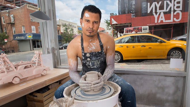 In this photo provided by Shannon Kirkman, taxi driver Luis Marte poses for the NYC Taxi Drivers calendar in New York.