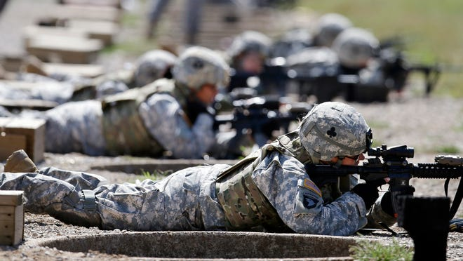 Female soldiers trained on a firing range in 2012 while wearing new body armor at Fort Campbell, Kentucky. Sept. 18, 2012