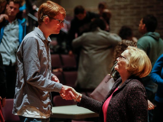 Sen. Claire McCaskill shakes hands with Jake Pinkston, a freshman at Missouri State University, following a town hall meeting in the Plaster Student Union Theatre on Tuesday, March 27, 2018.