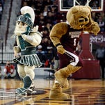 """Mississippi State mascot """"Bully"""" and the Michigan State mascot """"Sparty"""" dance in mid court during the second half of a second-round NCAA women's college basketball game Sunday, March 20, 2016, in Starkville, Miss."""