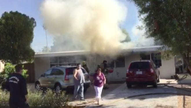 A house fire near Osborn Road and 30th Street displaced two people late Saturday afternoon.