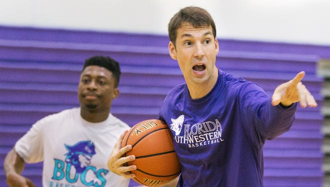 Florida SouthWestern State College's men's basketball coach Marty Richter leads practice recently at Cypress Lake High School in south Fort Myers.