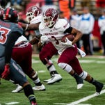 New Mexico State running back Larry Rose III and the Aggies host first-place Arkansas State on Saturday.